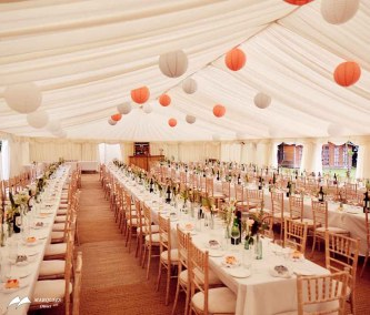 Image of long tables and brightly coloured ceiling lanterns
