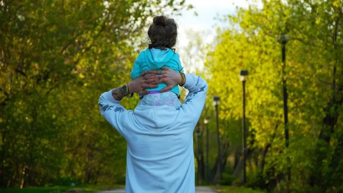 Daughter on Dad's shoulders