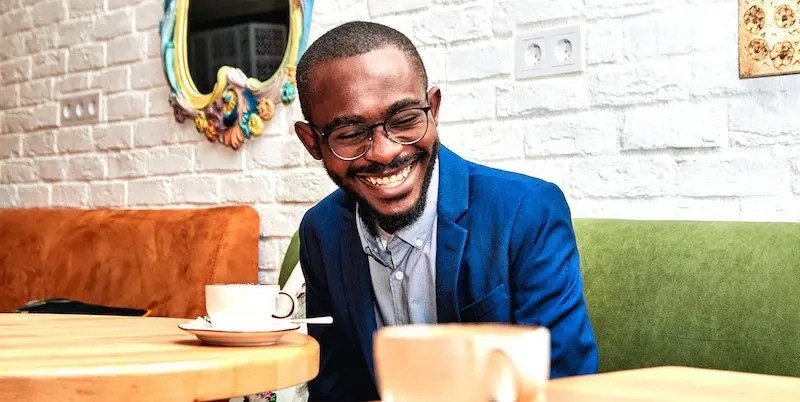 smiling man in coffee shop