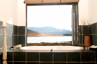 Bath with a view at Sani Valley Nature Lodges