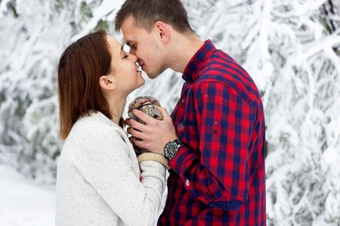 happy-young-couple-winter-white