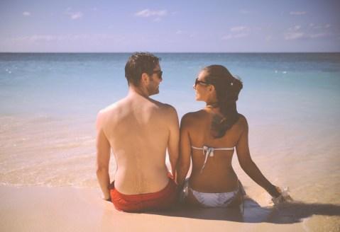 happy-couple-beach-holiday-honeymoon