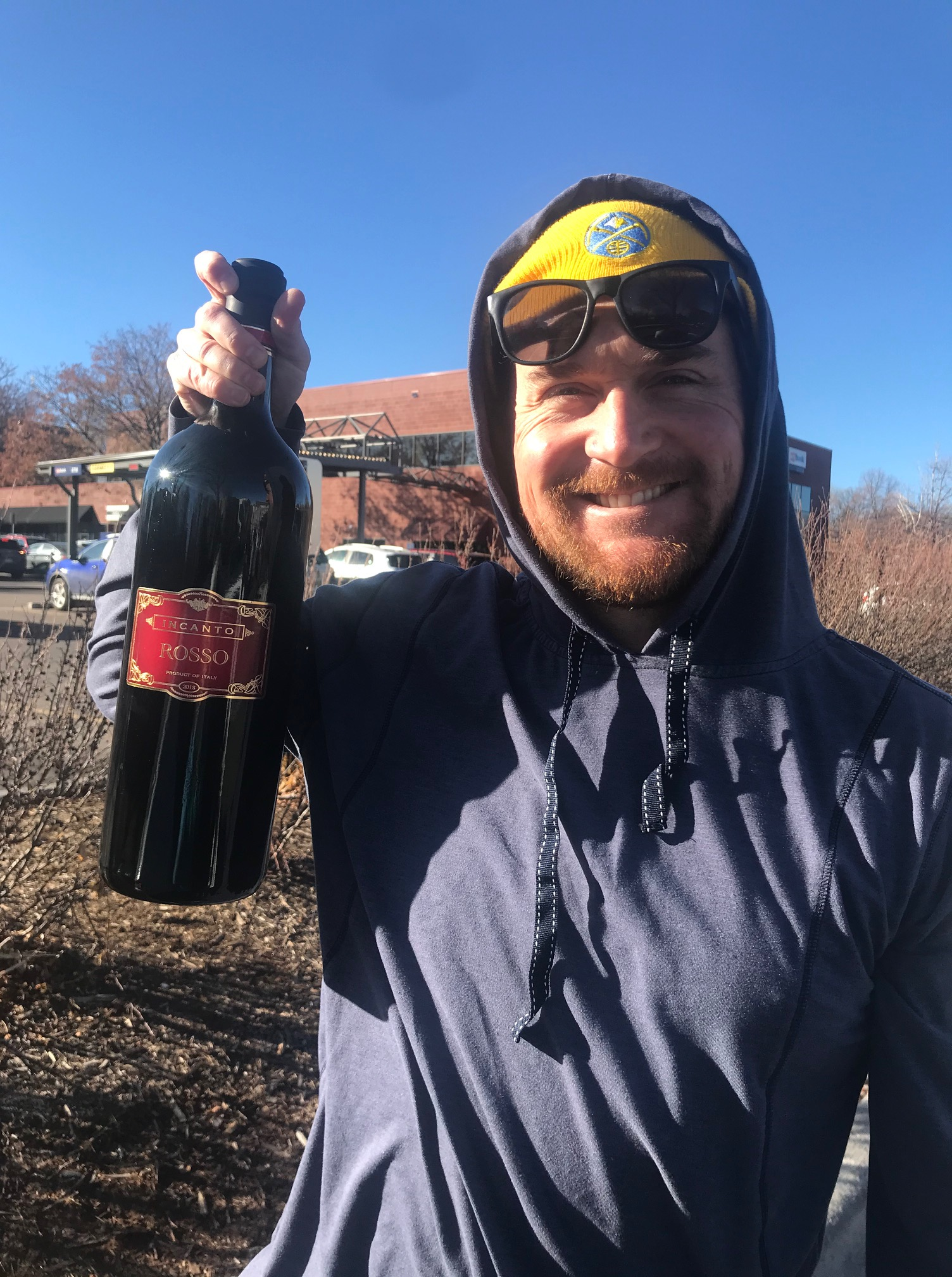 Tim with large wine from Trader Joe's