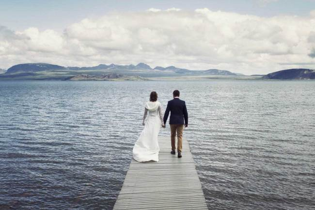 Happy married couple on a bridge in Iceland