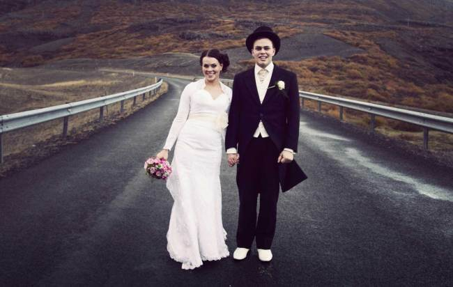 Happy married couple on a road in Iceland