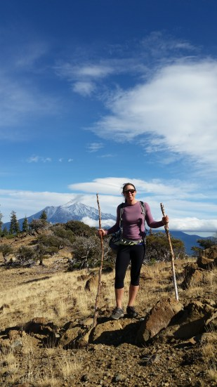 Heatha improvised hiking poles that afternoon, while Mount Shasta sits in the background.