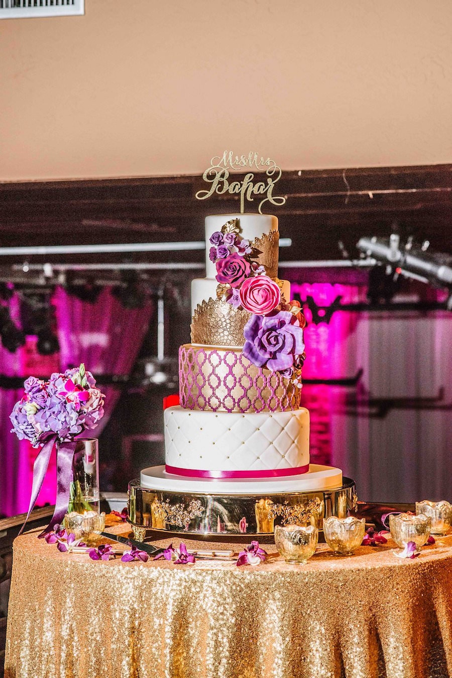 Four Tier Round Gold Pink And Purple Wedding Cake And