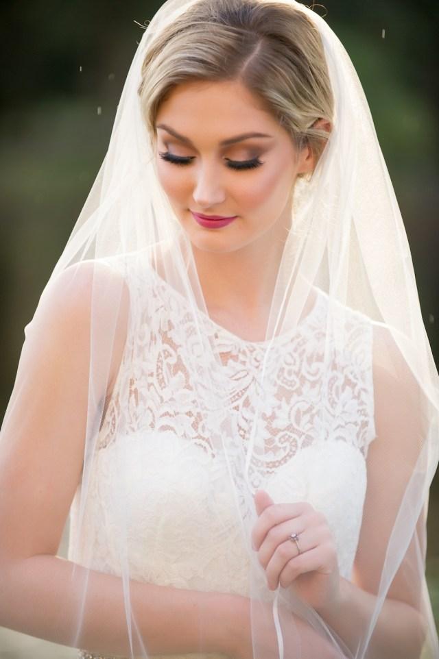 elegant traditional outdoor garden bridal portrait with veil