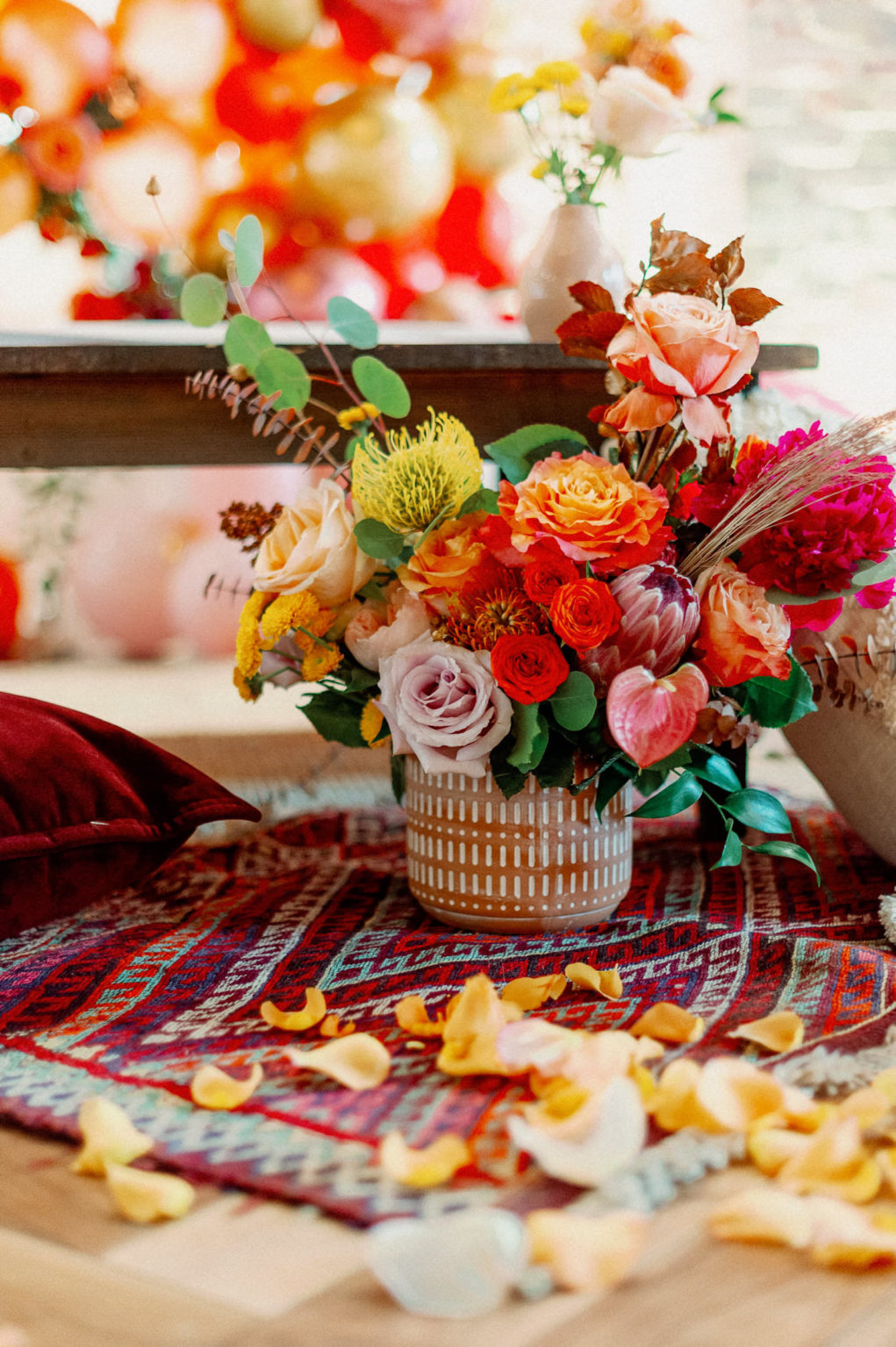 Whimsical and Colorful Wedding Reception Decor, Red Moroccan Style Rug, Blush Pink and Orange Roses, Yellow Pincushion Protea, Pink King Protea, Eucalyptus, Orange Flowers, Pink Anthurium, Yellow Rose Petals   Tampa Bay Wedding Photographer Dewitt for Love