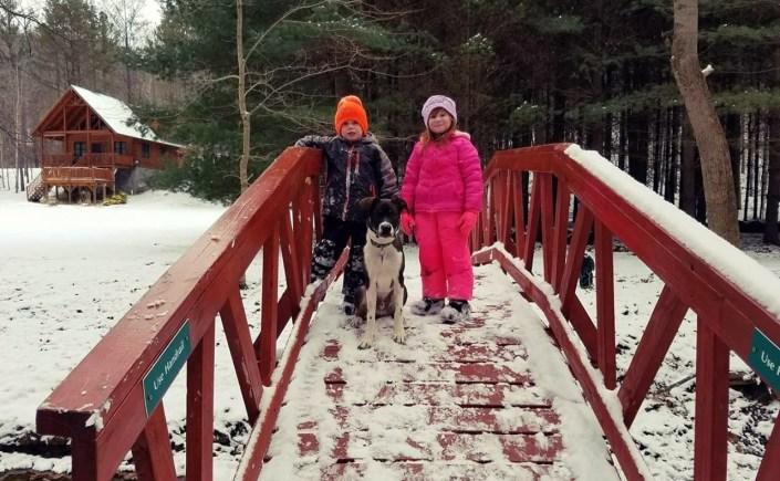 kids dog on bridge
