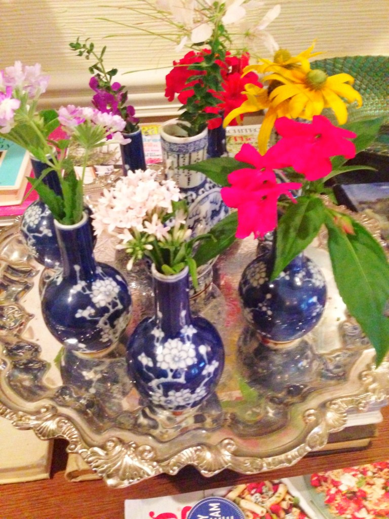 flowers in blue and white vases