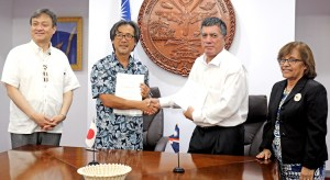 Japan Vice Minister of Foreign Affairs Iwao Horii (left) joined President Hilda Heine (right) at the signing ceremony for a new Japan-funded solar project for Ebeye Island. Signing the grant pact was Japan International Cooperation Agency Resident Representative Nobuaki Matsui and Foreign Minister John Silk.