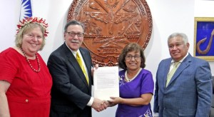 Interior Assistant Secretary Doug Domenech presents a grant award for Majuro Water and Sewer Company to President Hilda Heine Tuesday, as US Ambassador to RMI Karen Stewart and RMI Ambassador to the US Gerald Zackios look on. Photo: Hilary Hosia.