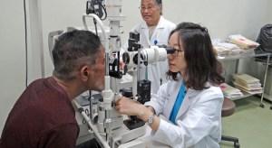 Dr. Shih-Wen Wang works with Mija Kaious while nurse Nosie Minor observes. Photo: Hilary Hosia