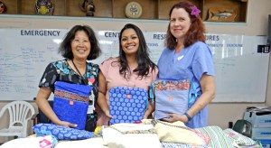 Canvasback Co-Founder Jacque Spence (left) joined with team member Gynecologist Kathy Hayes (right) to deliver a donation of supplies for patients at Majuro hospital. Receiving them on behalf of the ministry was Acting Secretary Francyne Wase-Jacklick. Photo: Hilary Hosia.