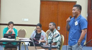 Health Minister Kalani Kaneko addresses a briefing session with local non government organizations. Ministry staff Mailynn Lang, Francyne Wase-Jacklick and Paul Alee are also pictured. Photo: Hilary Hosia.