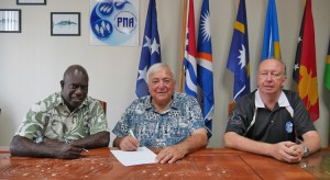 Signing the contract for construction of a new PNA HQ building in Majuro are, from left: PNA CEO Ludwig Kumoru and Pacific International Inc. CEO Jerry Kramer, as PNA Commercial Manager Maurice Brownjohn looks on. Photo: Rebecca Lathrop.