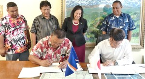 Utrok Mayor John Kaiko and Japan Embassy Charge Hiroshi Watanabe sign a grant agreement for funding to build a fish base on the northern atoll.