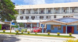 A view of the former Eastern Gateway Hotel across from Nitijela and the RMI capital building in Majuro. Nauru's Eigigu Corporation is contesting numerous subleases on the property. Photo: Hilary Hosia.
