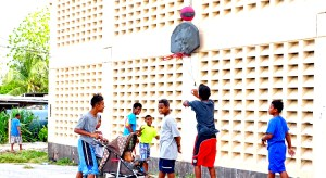 Since 2011, the ECC gym in Majuro has been locked up, useful only as a support for outdoor basketball backboards and hoops. Photo: Hilary Hosia.