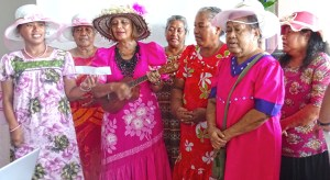 Nika Wase (playing ukulele) led a cancer survivor group in song at last week's Breast Cancer Awareness Pink Tea Party at Marshall Islands Resort. Photo: Kelly Lorennij.