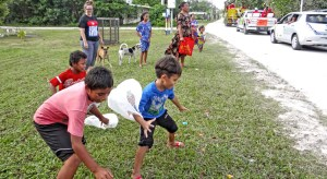 Children in Laura go for the candy being tossed from passing floats during last Saturday's Christmas parade. The parade was organized by the Trust Company of the Marshall Islands. Photo: Hilary Hosia.