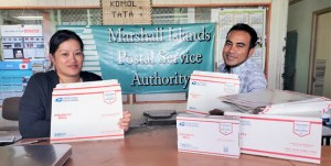 Post Office staff Cheryl Muller and Rommy Kaneko show off the newly arrived express and priority flat rate boxes, envelopes, tape and labels.