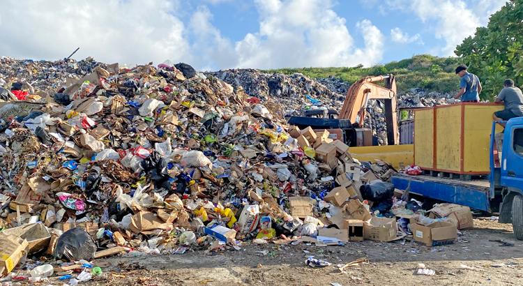 Dump overflows toward road
