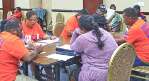 At the International Conference Center Saturday night, August 21, Electoral Administration staff started tabulation of votes cast in the special election to fill mayor and council seats. Photo: Wilmer Joel