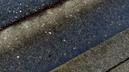 rain-soaked asphalt and concrete (and a drying line)