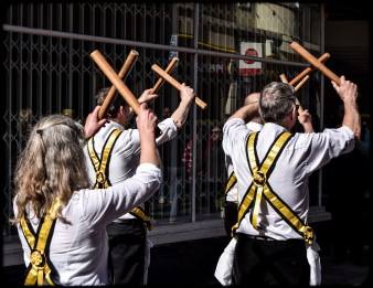 2016 Jack in the Green Yellow Morris Dancers Mid Dance Crossing Sticks small