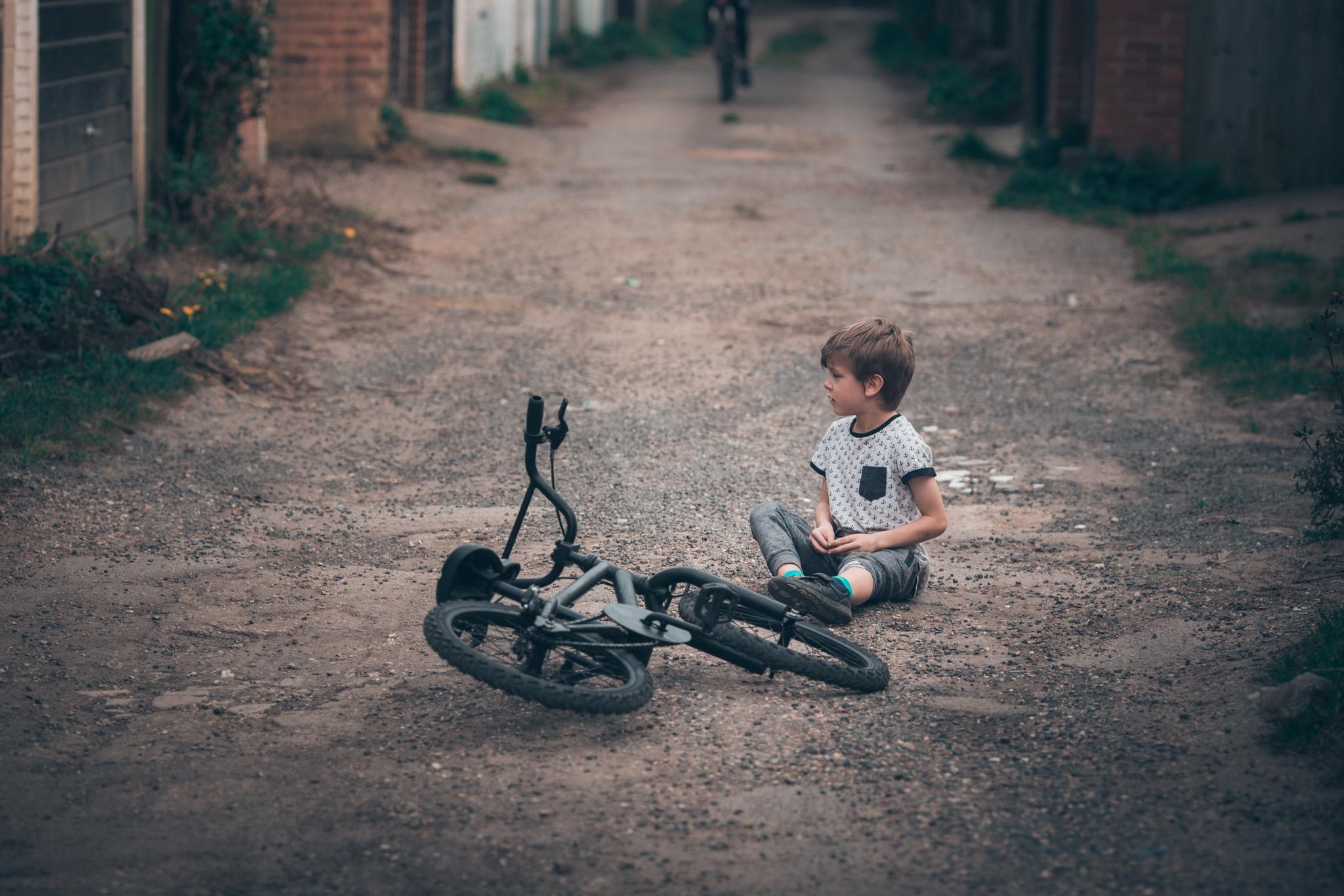 a boy off the bike