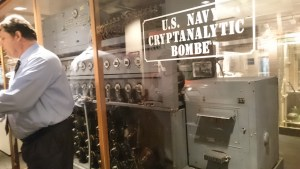 A not great picture of our Cryptologic Museum docent next to a code breaking machine