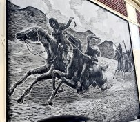 Mural in the square representing the Dedham Horse Thieves tale.