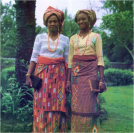 Nigerian women in traditional head ties, blouses and wrappers.