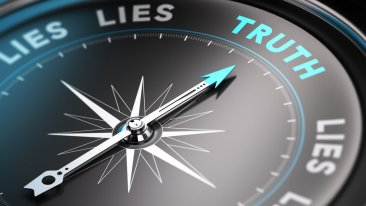 a compass with words lies and truth, pointing towards truth