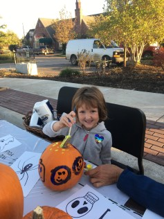 Violet Noel, age 5, paints a pumpkin courtesy Rosehill Gardens.