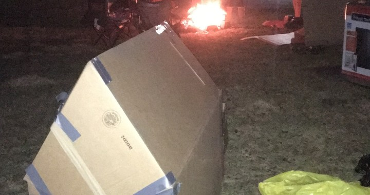 Boy Scouts collect donations while camping out in cardboard boxes