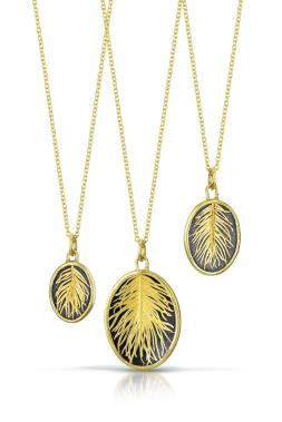 Edna Madera fuses razor-thin strips of gold onto silver for a feather-like effect..