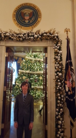 Here I am with the White House Christmas Tree in the Blue Room and the Presidential seal above the door.