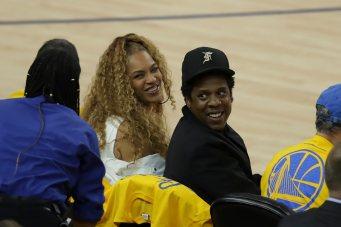 Queen B & Jay Z all smiles Photos by Kym Fortino Martinez News-Gazette