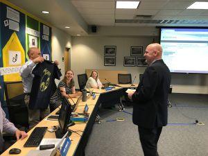 Tom Doppe, former AHS principal, presents a shirt to his newly hired successor, Matt Chamberlain