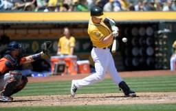 Oakland A's vs Houston Astros Mark Canha big swing Photos by Gerome Wright Martinez News-Gazette