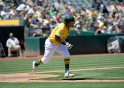 Oakland A's vs Houston Astros Khris Davis runs out a base hit Photos by Gerome Wright Martinez News-Gazette
