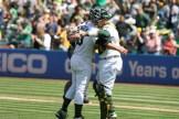 Oakland Athletics vs D-Backs Catcher #13 Bruce Maxwell congratulates winning pitcher #33 Daniel Mengden Photos by Tod Fierner Martinez News-Gazette
