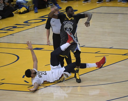 Draymond Green and Anthony Davis get tangled up on the floor. Photos by Gerome Wright Martinez News-Gazette