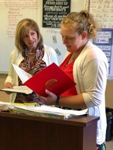 Ann Notarangelo gives certificate to Caroline Knapp