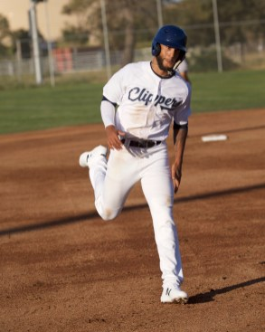 Trey Hunt cruises into third base.