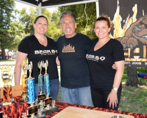 Steve Likos, owner of Bear•B•Q, and his daughters Nicole and Angela