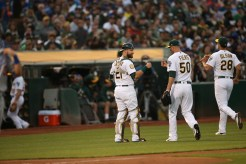 Oaklands A's vs LA Dodger's Lucroy fist bumps Fiers Photos by Tod Fierner ( Martinez News-Gazette )